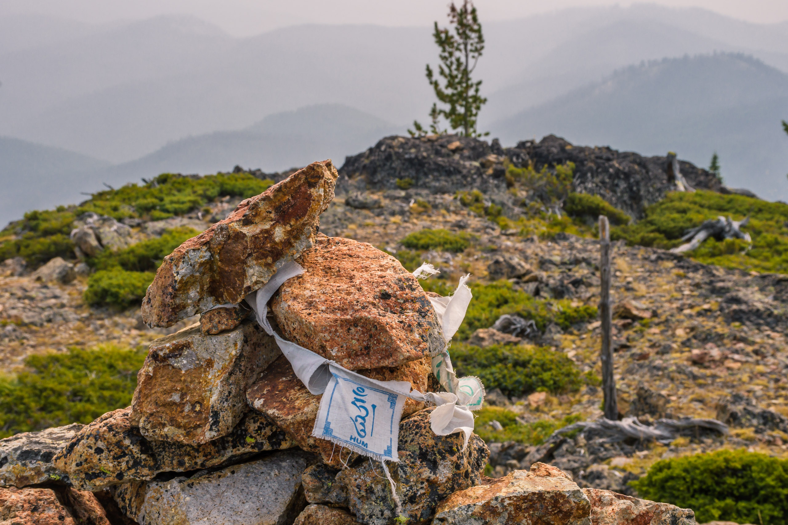 Prayer flag at the summit cairn