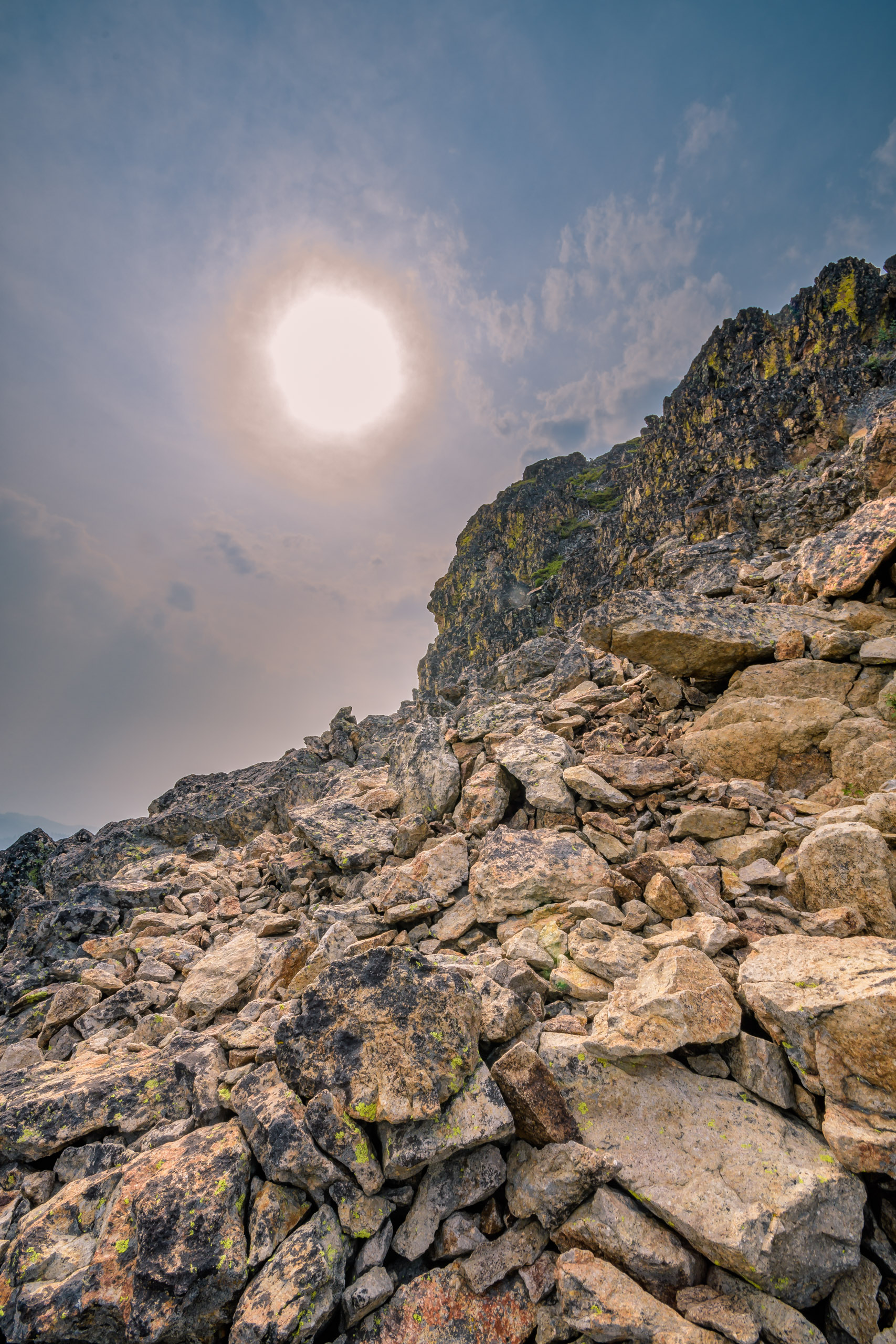 Scrambling over the talus and boulders to the top